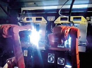 Spawanie z dwoma robotami ABB IRB 1600 przy jednym pozycjonerze IRBK